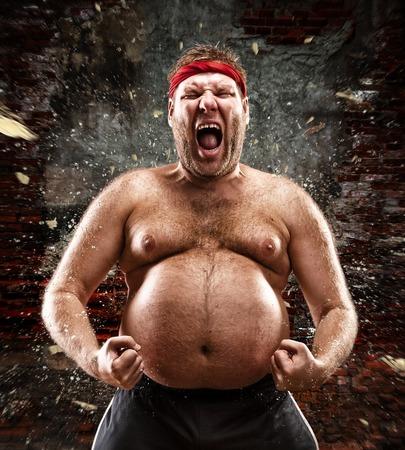 Furious man screams against blow Stock Photo