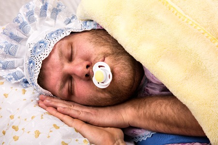 Crazy man weared as baby sleeping Stock Photo - 25933220