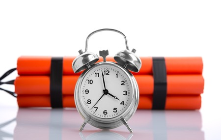 Alarm clock and dynamite side view Stock Photo - 26364083