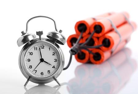 terrorism crisis: Alarm clock and dynamite on white