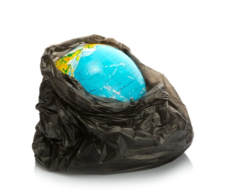 Earth inside litter pack on white photo