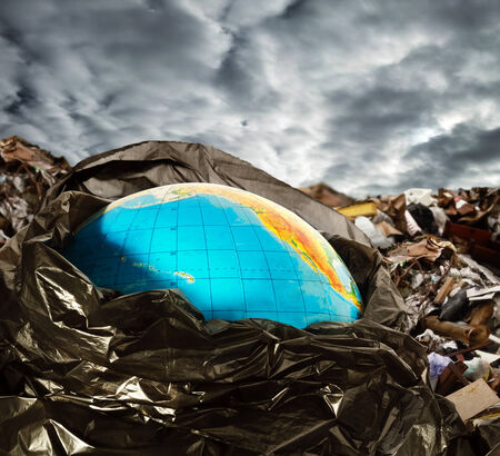 Earth contamination concept. Litter and dramatic sky photo