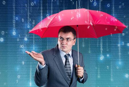 Office worker hiding under an umbrella from digital rain photo