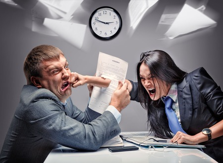 Two office workers starting to fight Stock Photo