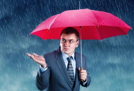 red umbrella: Office worker hiding under an umbrella from rain