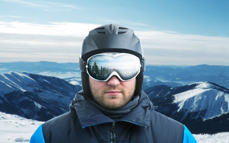 goggle: Mountain-skier against mountain with reflection in googles