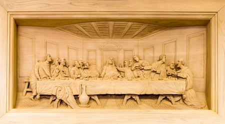 stone carving: Lords Supper wood carving in frame Stock Photo
