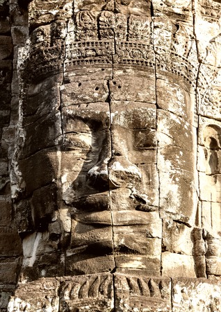 thom: Stone face on towers of Bayon temple closeup