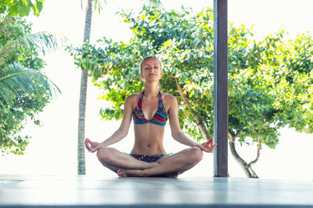 Women in ditating in  lotus asana in Thailand Stock Photo - 27074171