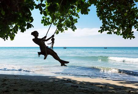 Women on swings  in Thailand Stock Photo - 27074170