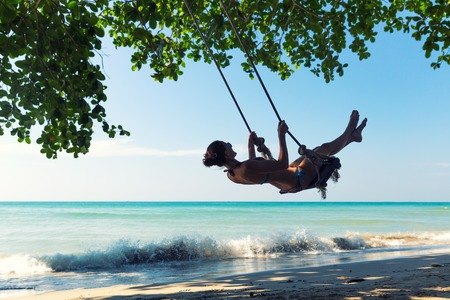 Female on swings in Thailand Stock Photo - 27074169