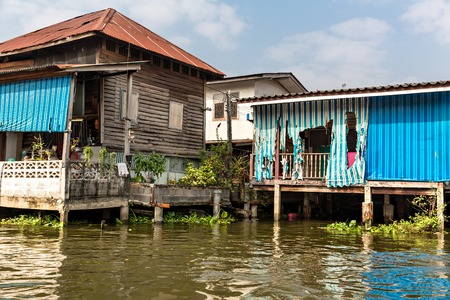 underprivileged: Slums on dirty canal in Asia