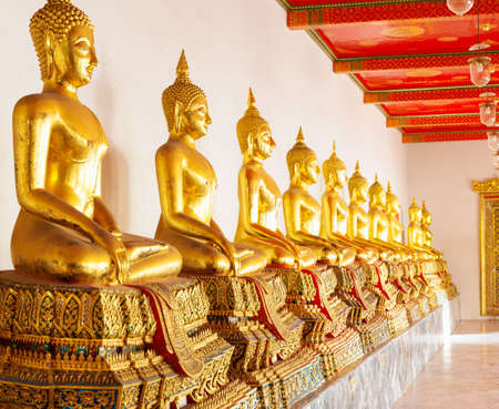 Buddha statues in row (Wat Po Temple, Thailand) photo