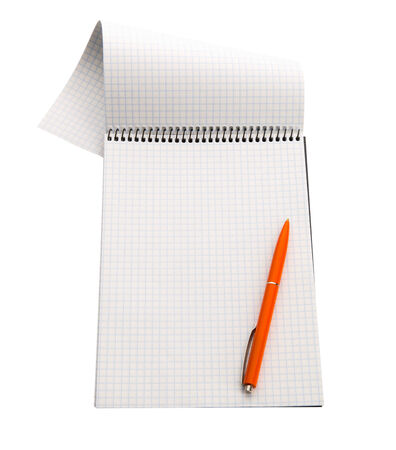 note pad and pen: checkered paper notebook isolated on white with orange pen