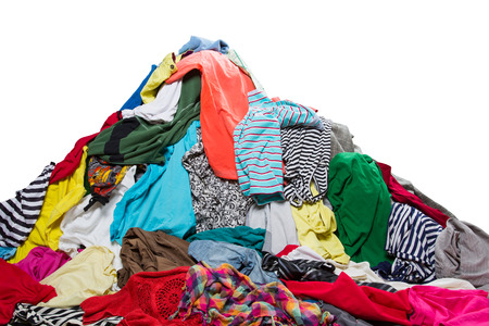 pile reuse: Big heap of colorful clothes isolated on white
