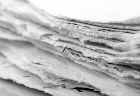 Ragged paper sheets closeup picture photo