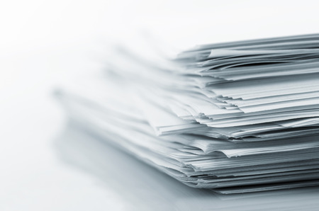 Stack of white papers isolated on white Stock Photo