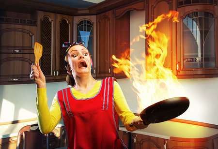 Housewife cooking on the kitchen with big fire