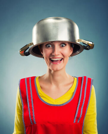 sause: Portrait of happy housewife with sause pan on her head