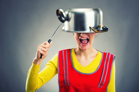 sause: Crazy housewife with sause pan on her head Stock Photo