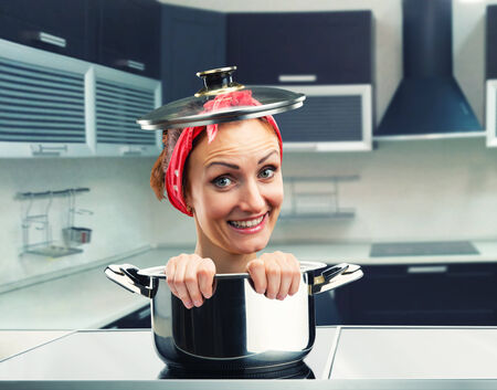 sause: Smiling housewife inside sause pan