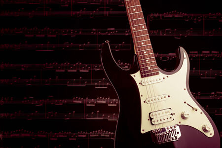 electric guitar: Electric guitar with notes Stock Photo