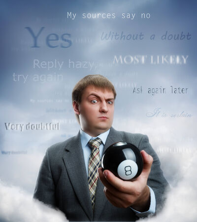 Businessman holding magic ball in his hand photo