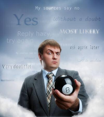 magic ball: Businessman holding magic ball in his hand