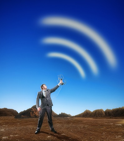 airwaves: Businessman creating airwaves with antenna on the nature