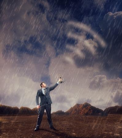 airwaves: Businessman creating airwaves with antenna in storm