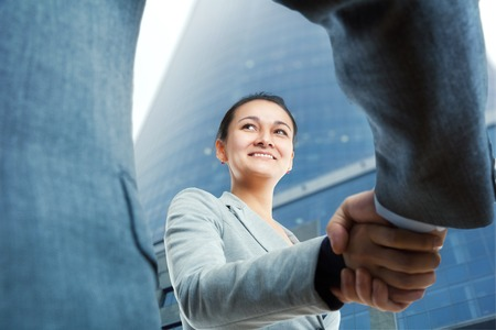 businesswoman: Happy businesswoman and client handshaking Stock Photo