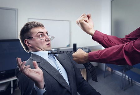 Aggressive office worker fighting with employee