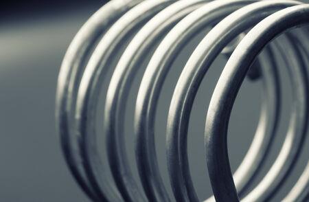Aluminum spirals isolated on gray background photo