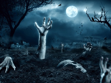 tombstones: Zombie hand coming out of his grave. Full moon, halloween night