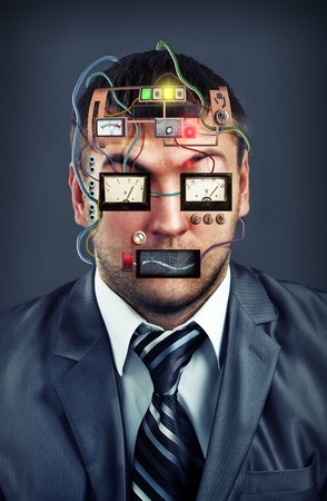 Portrait of businessman with electric devices instead of face photo