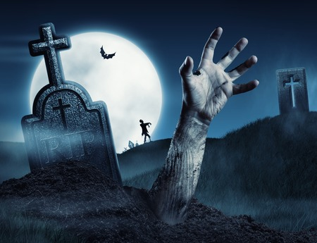 Zombie hand coming out of his grave. Full moon Stock Photo