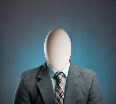 beginner: Businessman with egg head on blue