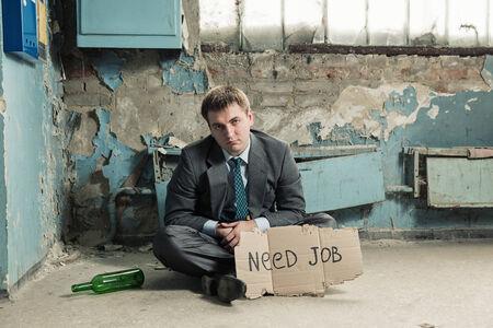 hobo: Poor homeless businessman holding sign asking for new job