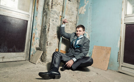 Captive man with handcuffed hand in old house Stock Photo - 28648213