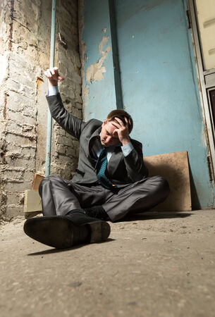 Arrested businessman with handcuffed hand in old house Stock Photo - 28648215