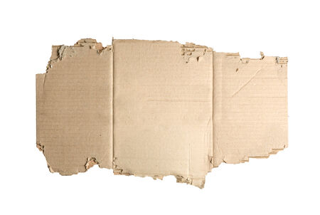 corrugate: Brown cardboard torn  isolated on white. Stock Photo