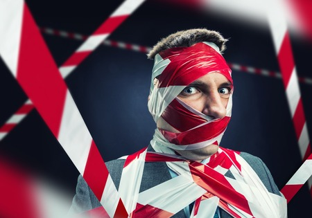outspoken: Scared man with stripped duct tape over body Stock Photo