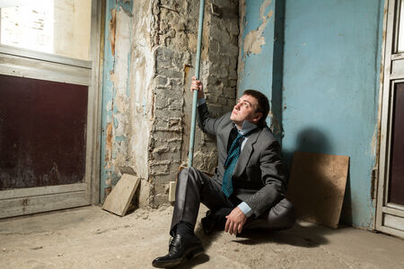 Arrested man with handcuffed hand in old house Stock Photo - 28648675