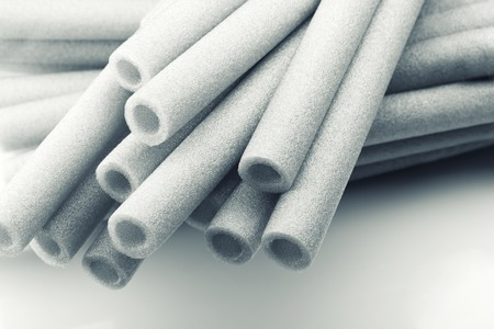 Closeup view of rolls of thermal insulation foam pipe photo