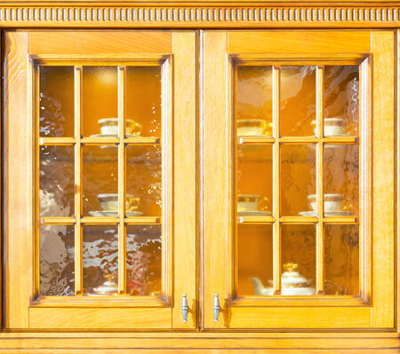 Luxury kitchen cupboard made from light wood photo