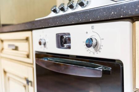 Closeup picture of  white oven in kitchen interior design photo