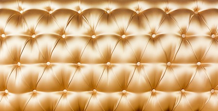 luxurious background: Buttoned yellow texture. Luxurious background.
