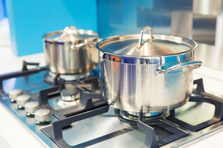 Stove with two saucepans on the modern kitchen