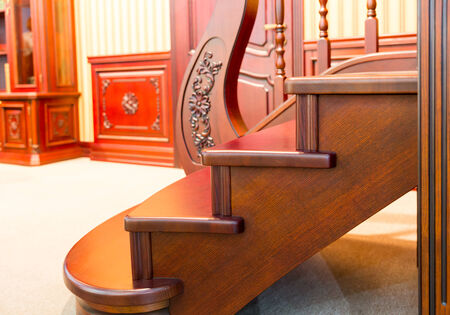 Modern staircase made from nice brown wood closeup photo