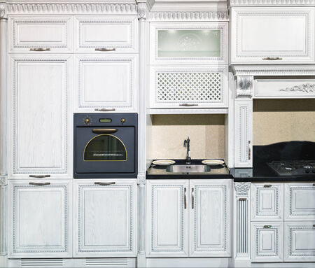 Luxury kitchen made from light white wood photo